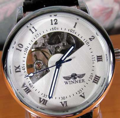 Швейцарские механические часы омск